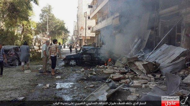 Oct. 5, 2015: People gather at the site of an airstrike in Al-Bab on the outskirts of Aleppo, Syria.