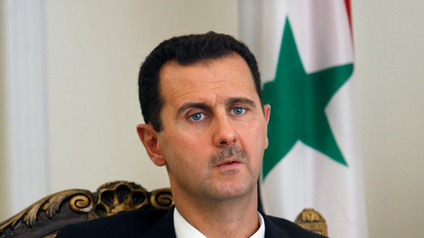 Aug. 19, 2009 - FILE photo of Syrian President Bashar Assad at a meeting. Syrian parliament speaker says Assad has declared his candidacy for the June 3 presidential elections.