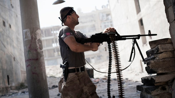 Sept. 26, 2012 - Free Syrian Army fighter fires at Syrian Army positions during a clash in Aleppo, Syria.
