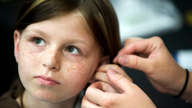 Battles with bone cancer left Zahra Clare Baker, 10, with hearing aids in both ears and a prosthetic leg. Her father and stepmother reported her missing Oct. 9, but recent evidence found at the Baker residence may now point to homicide.