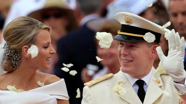 July 2, 2011: In this file photo, Prince Albert II of Monaco and Princess Charlene of Monaco depart from the Monaco palace after their religious wedding ceremony. (AP)