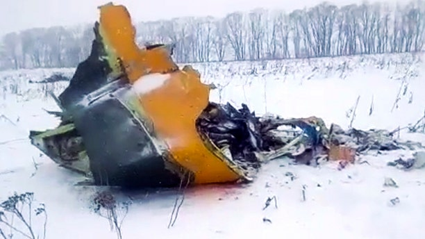 In this screen grab provided by the Life.ru, the wreckage of a AN-148 plane is seen in Stepanovskoye village, about 25 miles from the Domodedovo airport, Russia, Sunday, Feb. 11, 2018.