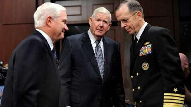 Rep. John P. Murtha, D-PA, (C) escorts Secretary of Defense Robert Gates (L) and Chairman of the Joint Chiefs of Staff Adm. Michael Mullen to testify before the House Defense Appropriations Subcommittee on the fiscal year 2010 defense budget, on Capitol Hill, May 20, 2009. (Reuters)