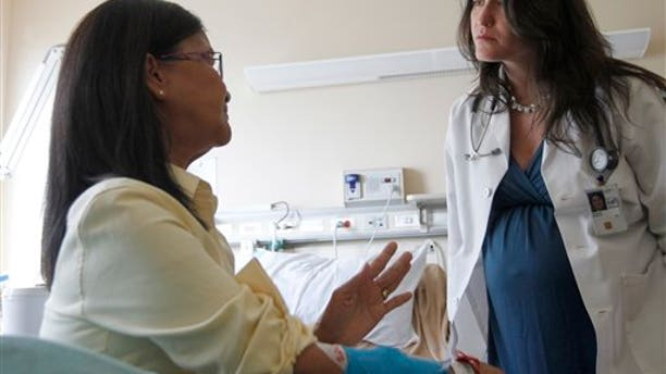 Aug. 22, 2012: Dr. Sarah K. Browne,right, talks with patient Kim Nguyen at National Institute of Health in Bethesda, Md.