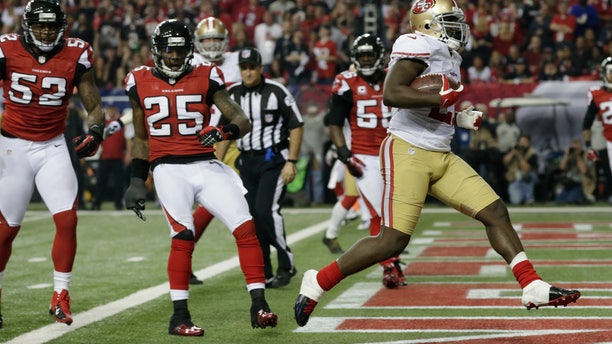 Jan. 20, 2013: San Francisco 49ers' Frank Gore rushes for a five-yard touchdown during the second half of the NFL football NFC Championship game against the Atlanta Falcons in Atlanta. Left is Atlanta Falcons' Akeem Dent and William Moore.