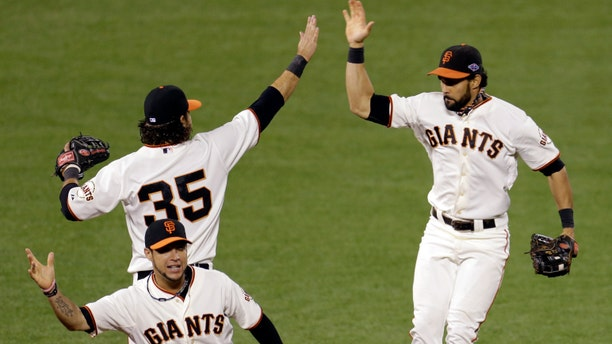 San Francisco Giants' Brandon Crawford (35), Angel Pagan, right, and Gregor Blanco celebrate after Game 6 of baseball's National League championship series against the St. Louis Cardinals Sunday, Oct. 21, 2012, in San Francisco. The Giants won 6-1 to tie the series at 3-3. (AP Photo/Eric Risberg)
