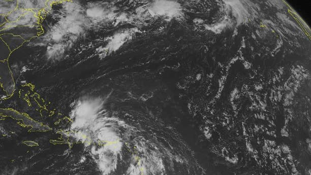 This NOAA satellite image taken Friday, Aug. 22, 2014 at 10:45 a.m. EDT shows a widespread area of disorganized clouds, ranging from the Turks and Caicos to Lesser Antilles, associated with a potential developing tropical depression near Puerto Rico. Generally fair conditions are dominating the remaining areas of the Caribbean region and central and northern Bahamas as well as Cuba. (AP Photo/Weather Underground)