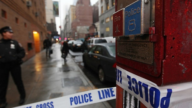NEW YORK, NY - DECEMBER 10:  Police cordon off the scene of a fatal shooting at 202 West 58th Street in Manhattan on December 10, 2012 in New York City.  The victim, identified as a male was shot in the head in broad daylight on the sidewalk and has since been pronounced dead.  (Photo by Mario Tama/Getty Images)