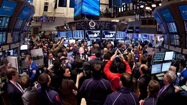 March 2, 2012: Traders crowd on the floor of the New York Stock Exchange.