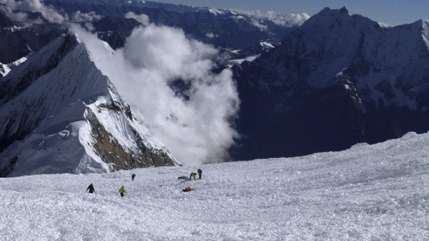 Sept. 23, 2012: In this picture released by Alpine Ascents International, rescuers search for survivors and victims in the debris field of an avalanche on Mount Manaslu in northern Nepal.