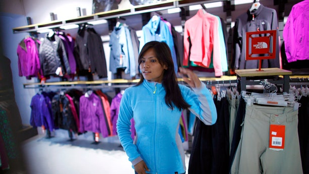 Feb. 21, 2013: Nepalese climber Asha Singh looks at climbing gear at a store in Katmandu, Nepal. Aiming to change the all-male image of mountaineering in the country, a group of Nepalese women have embarked on a mission to climb the tallest mountain on each of the seven continents.