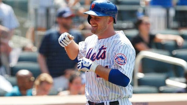 NEW YORK, NY - MAY 27: Lucas Duda #21 of the New York Mets smiles after hitting his second home run of the game in the fifth inning against the Philadelphia Phillies at Citi Field on May 27, 2015 in Flushing neighborhood of the Queens borough of New York City. (Photo by Mike Stobe/Getty Images)