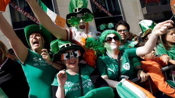 Mar. 17, 2012: Deirdre Kelly, left, Linda Forth, second from left, Darren McCarthy, center, and Eimear Ni Bhriain, of Dublin, Ireland, cheer on the marchers during the 251st annual St. Patrick's Day Parade.
