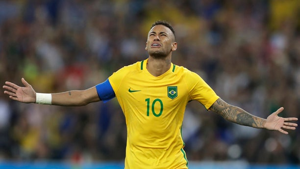 Brazil's Neymar celebrates after scoring the decisive penalty kick during the final match of the men's Olympic football tournament between Brazil and Germany at the Maracana stadium in Rio de Janeiro, Brazil, Saturday Aug. 20, 2016. Brazil won the gold medal on a penalty shootout. (AP Photo/Andre Penner)