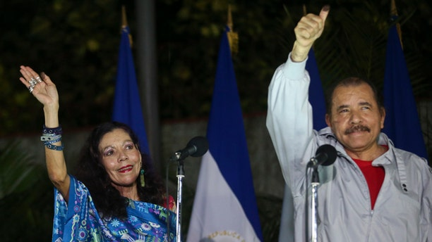 Daniel Ortega and his wife after casting their ballots in Managua, Nicaragua, Sunday, Nov. 6, 2016.