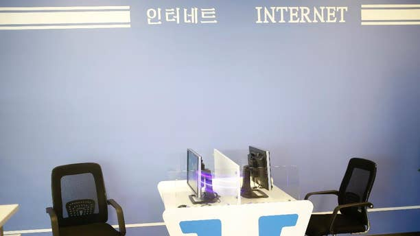 In this Monday, Aug. 24, 2015 photo, computers with no keyboard provided are seen at an Internet corner at the airport in Pyongyang, North Korea. The new airport building has just about everything including the Internet room. The problem is, it doesn't seem to work. (AP Photo/Dita Alangkara)