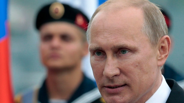 FILE - In this May 9, 2014 file photo, Russian President Vladimir Putin heads to speak at a navy parade marking  Victory Day in Sevastopol, Crimea. (AP Photo/Ivan Sekretarev, File)
