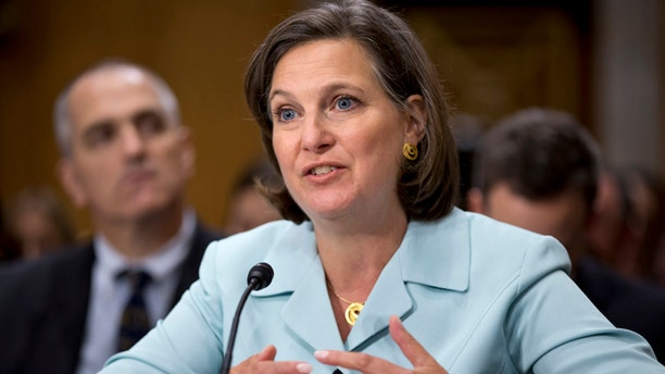 Juy 11, 2013: In this photo Victoria Nuland testifies on Capitol Hill in Washington, before the Senate Foreign Relations Committee.