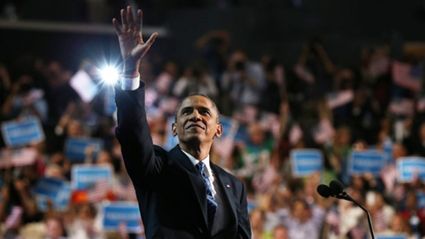 CHARLOTTE, NC - SEPTEMBER 06:  Democratic presidential candidate, U.S. President Barack Obama waves on stage during the final day of the Democratic National Convention at Time Warner Cable Arena on September 6, 2012 in Charlotte, North Carolina. The DNC, which concludes today, nominated U.S. President Barack Obama as the Democratic presidential candidate.  (Photo by Justin Sullivan/Getty Images)