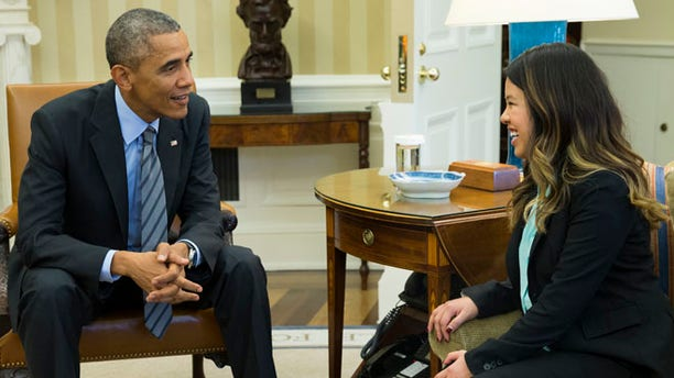 In this Friday, Oct. 24 photo, President Barack Obama meets with Ebola survivor Nina Pham in the Oval Office of the White House in Washington.