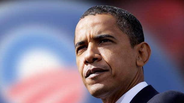 AP/Then Senator Obama campaigns in 2008