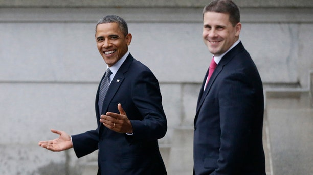 Jan. 16, 2013: President Barack Obama, accompanied by White House Communications Director Dan Pfeiffer, reacts to a reporter's question about the event he was leaving at the Treasury Department.