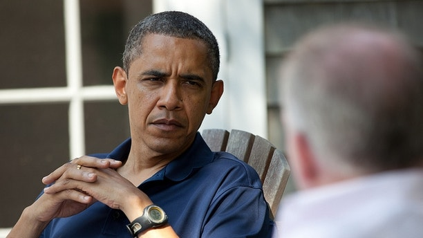 President Obama is briefed on the first day of his Martha's Vineyard vacation.  (White House Photo)