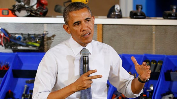 President Barack Obama answers a question Tuesday, June 17, 2014, in Pittsburgh.