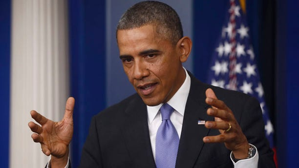 Nov. 14, 2013: President Barack Obama gestures as he speaks about his signature health care law.