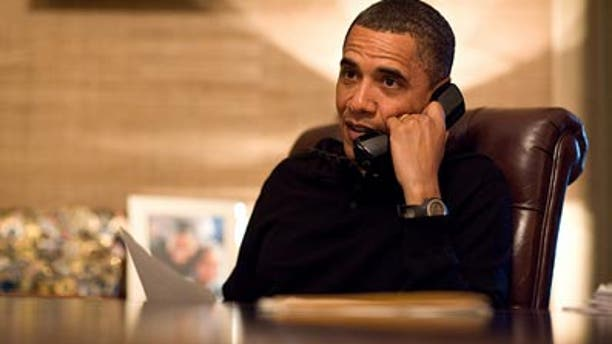 President Obama speaks with Elena Kagan on Sunday, May 9. White House photo