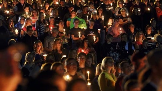 Community members attend a candlelight vigil at Stewart Park for those killed during a shooting at Umpqua Community College in Roseburg, Ore., Thursday, Oct. 1, 2015. (Michael Sullivan/The News-Review via AP) MANDATORY CREDIT
