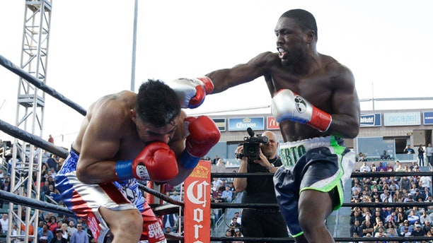 Andre Berto, right, lands a punch to Victor Ortiz during the fourth round of a welterweight boxing match, Saturday, April 30, 2016, in Carson, Calif. Berto won by knockout in the fourth round. (AP Photo/Jae C. Hong)