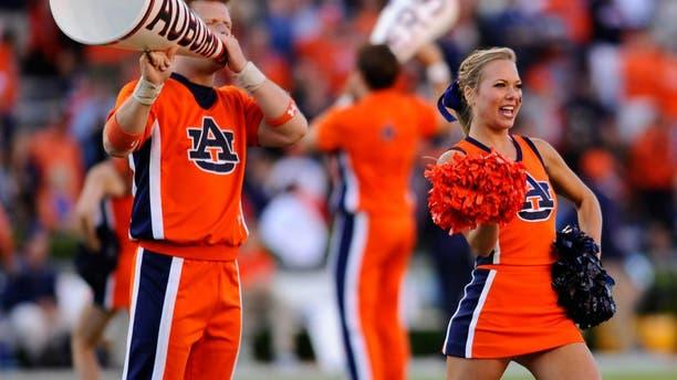 Oct 4, 2014; Auburn, AL, USA; Auburn Tigers cheerleaders perform prior to the game against the LSU Tigers at Jordan Hare Stadium. Auburn won 41-7. Mandatory Credit: Shanna Lockwood-USA TODAY Sports