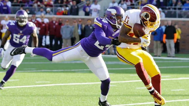 Washington Redskins wide receiver DeSean Jackson (right) catches a 13-yard touchdown pass in front of Minnesota Vikings cornerback Captain Munnerlyn during the second half.