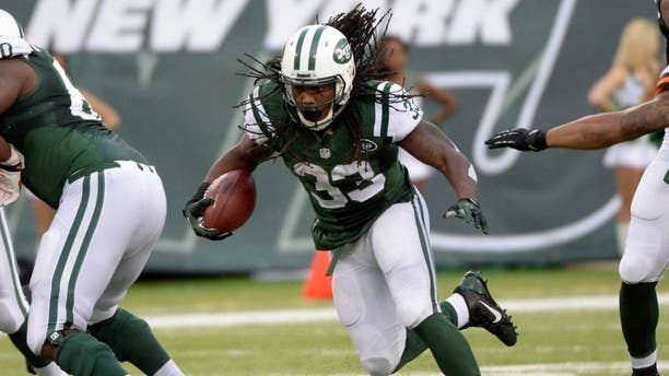 Dec 22, 2013; East Rutherford, NJ, USA; New York Jets running back Chris Ivory runs against the Cleveland Browns during the game at MetLife Stadium. Mandatory Credit: Robert Deutsch-USA TODAY Sports