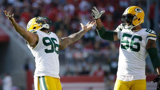 Green Bay Packers defensive tackle Mike Neal (left) and outside linebacker Julius Peppers celebrate during the second half against the San Francisco 49ers in Santa Clara, Calif., on Sunday, Oct. 4, 2015. The Packers won 17-3.