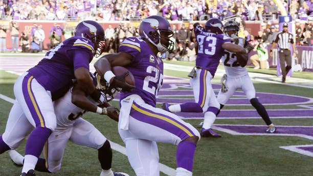 Minnesota Vikings running back Adrian Peterson gets into the end zone with a 6-yard run for a touchdown during the first half against the St. Louis Rams on Sunday, Nov. 8, 2015, in Minneapolis.