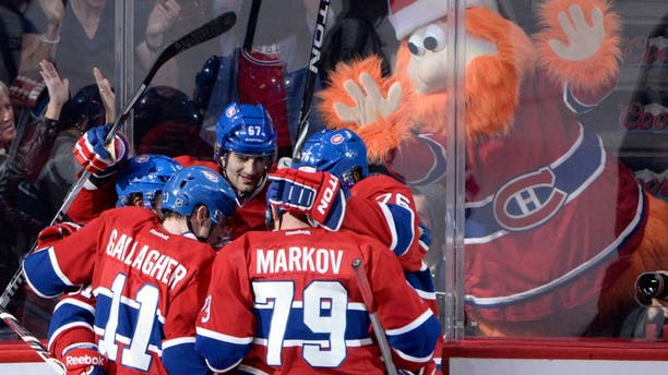 Dec 17, 2013; Montreal, Quebec, CAN; Montreal Canadiens forward Max Pacioretty (67) celebrates with teammates Brendan Gallagher (11) and P.K. Subban (76) and Andrei Markov (79) with team mascot Youppi in the background after scoring a goal against the Phoenix Coyotes during the third period at the Bell Centre. Mandatory Credit: Eric Bolte-USA TODAY Sports