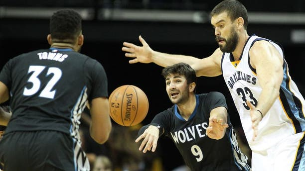 Nov 19, 2016; Memphis, TN, USA; Minnesota Timberwolves guard Ricky Rubio (9) passes to center Karl-Anthony Towns (32) as Memphis Grizzlies center Marc Gasol (33) defends at FedExForum. Memphis defeated Minnesota 93-71. Mandatory Credit: Nelson Chenault-USA TODAY Sports