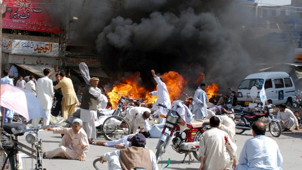 September 3: Injured people lie down on road after an explosion during a Shiite procession in Quetta, Pakistan. Police say a blast at a Shiite procession has killed many people in southwestern Pakistan in the third deadly attack this week on the country's religious minorities. (AP)