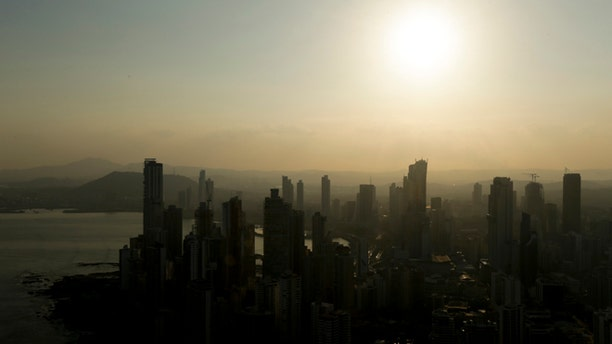 Panama City skyline is silhouette at sunset in Panama, Monday, April 4, 2016.