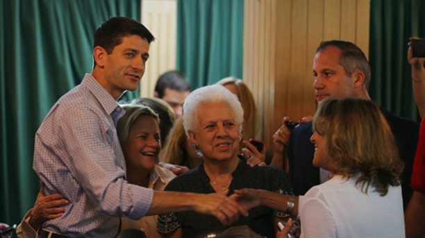 MIAMI, FL - SEPTEMBER 22:  Republican vice presidential candidate, U.S. Rep. Paul Ryan (R-WI) greets people during a campaign stop at Versailles restaurant in the Little Havana neighborhood on September 22, 2012 in Miami, Florida. Ryan continues to campaign for votes across the country.  (Photo by Joe Raedle/Getty Images)