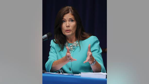 In this June 23, 2014 file photo, Pennsylvania state Attorney General Kathleen Kane fields questions from the media at a news conference in Harrisburg, Pa. Kane said Wednesday, Nov. 12, 2014 four of her employees have been fired and 11 suspended without pay for involvement in a pornographic email scandal that also prompted a state Supreme Court justice to step down. (AP Photo/Bradley C Bower)
