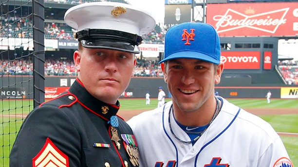 Sept. 24: Medal of Honor recipient Dakota Meyer of the U.S. Marine Corps is presented with an American flag by New York Mets' Josh Thole.