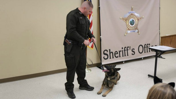 Deputy Pickett seen with his canine partner, Brick.
