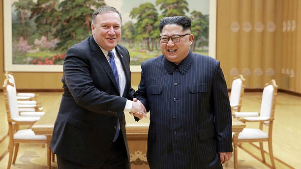 """North Korean leader Kim Jong Un (right) shakes hands with U.S. Secretary of State Mike Pompeo (left), who left North Korea early Wednesday morning with the three American detainees, whom the Trump administration had referred to as """"hostages."""" (KCNA)"""