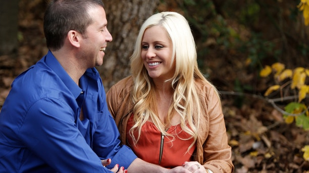 """This undated image released by WE TV shows pregnant Megan Aballi meeting a date at a park in a scene from """"Pregnant & Dating."""""""