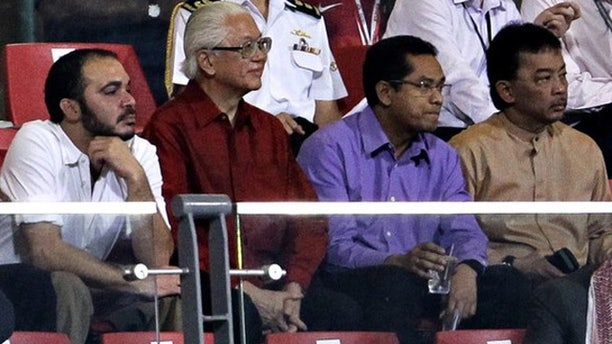 Oct. 11, 2011: Prince Ali Bin al Hussein of Jordan (L) watches as Jordan plays Singapore in their 2014 FIFA World Cup qualifying soccer match in Singapore with Singapore's President Tony Tan and Malaysia's Tengku Abdullah Sultan Ahmad Shah.