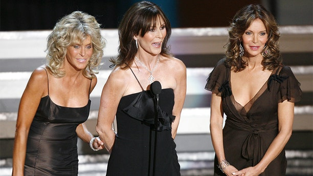 """The original """"Charlie's Angels,"""" actresses Farrah Fawcett (L), Kate Jackson and Jaclyn Smith, appear during a tribute to producer Aaron Spelling during the 58th annual Primetime Emmy Awards at the Shrine Auditorium in Los Angeles August 27, 2006."""