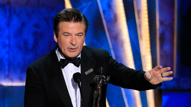 """Actor Alec Baldwin accepts the award for outstanding performance by a male actor in a comedy series for """"30 Rock"""" at the 18th annual Screen Actors Guild Awards in Los Angeles, Calif. on Jan. 29, 2012."""